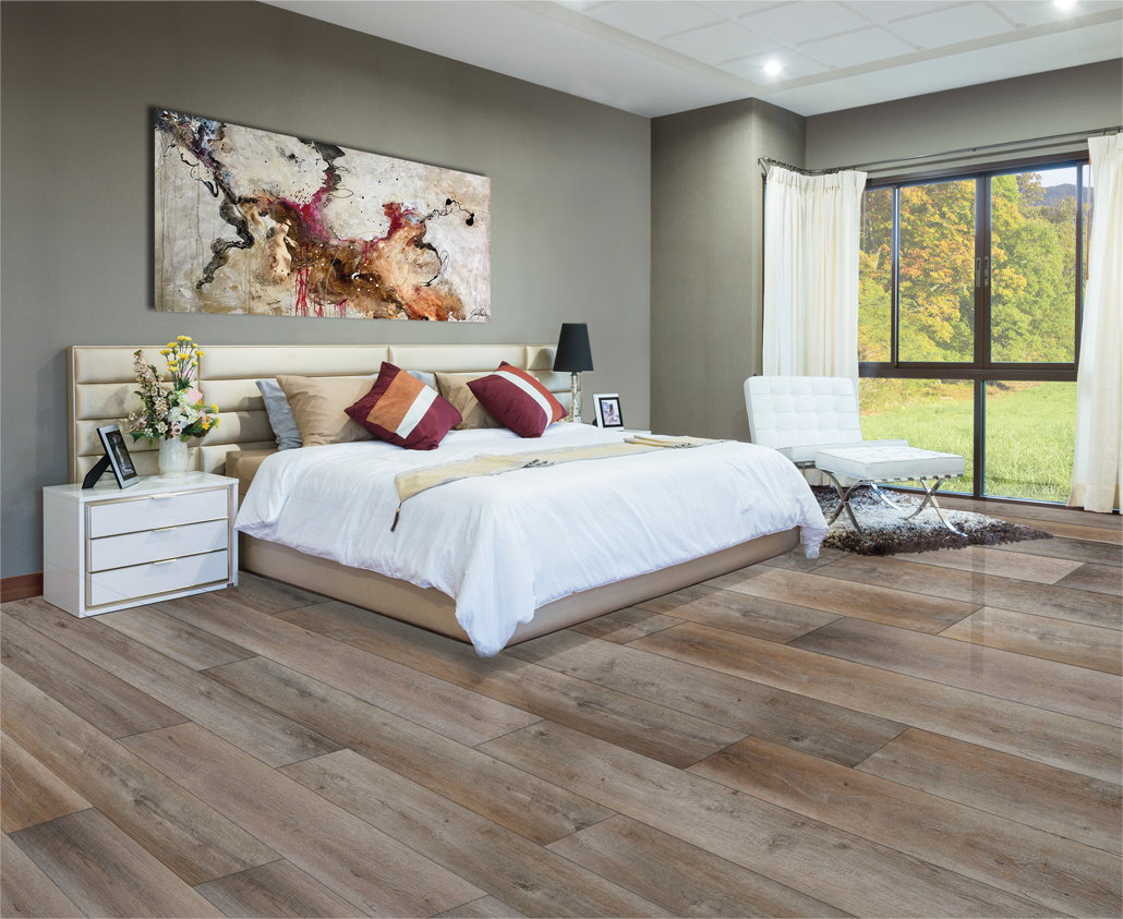 Big bed in a room covered with appalachian oak flooring